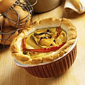 Individual Serving of Tofu Pesto Quiche with Bell Peppers and Onions