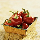 Fresh Cherry Peppers in a Small Square Container