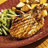 A Grilled Pork Chop with Honey-Maple Glaze, Green Beans and Potatoes