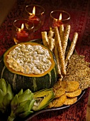 Artichoke Dip with Artichokes, Crackers and Breadsticks