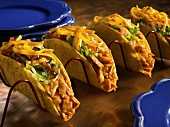 Four Chicken Tacos in a Taco Rack