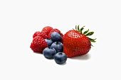 Blueberries, Raspberries and a Strawberry on White