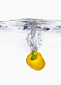 A Yellow Bell Pepper Splashing into Water