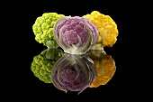 A Green, a Purple and a Yellow Head of Cauliflower