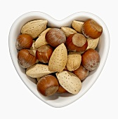 Hazelnuts and Almonds in a Heart Shaped Bowl