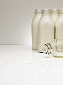 Milk Bottles, One on its Side