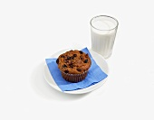 A Raisin Bran Muffin with a Glass of Milk