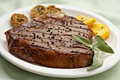 A Grilled Porterhouse Steak with Cracked Black Pepper