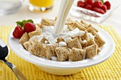 Milk Pouring Over Shredded Wheat Cereal