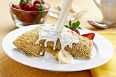Milk Splashing Over Shredded Wheat Cereal with Bananas and Strawberries
