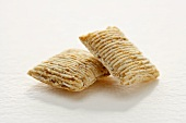 Two Pieces of Shredded Wheat Cereal on White