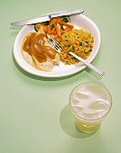 Sliced Turkey Entrée with Gravy, Rice Pilaf and Mixed Vegetables and a Glass of Ginger Ale