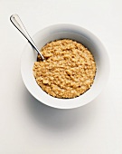 Bowl of Oatmeal on a White Background; From Above
