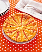A Bell Pepper Frittata on an Orange Polka Dotted Tablecloth