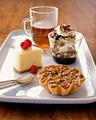 Bite Sized Desserts on a Rectangular White Platter with Tea