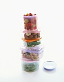 A Stack of Storage Containers Filled with Various Foods