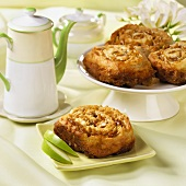 A Cinnamon Apple Roll with Walnuts on a Square Green Plate