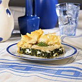 A Piece of Spinach and Feta Pie in Phyllo (Spanakopita)