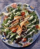 A Green Salad with Cherry Tomatoes and Carrots