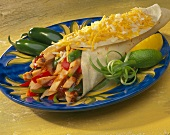A Chicken Fajita Topped with Shredded Cheese