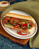 A Sausage, Bell Pepper and Onion Sub
