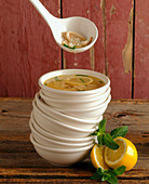 Chicken, Lemon and Rice Soup in a Stack of Bowls