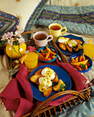 Eggs Benedict on Grilled Bread Slices with Fresh Fruit, Juice and Tea