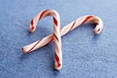 Two Candy Canes on a Blue Background