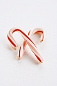 Two Candy Canes on a White Background