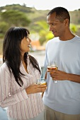 Couple with drinks in the open air