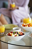 Fruit Salad, Coffee and Orange Juice on a Coffee Table