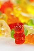 A Red Gummy Bear with Others Behind