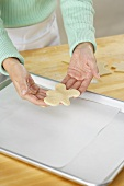 Placing an Unbaked Cookie on a Cookie Sheet