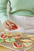 Putting Sprinkles on Holiday Cookies