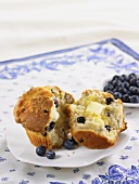 A Blueberry Muffin, Halved, with Butter