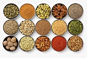 Assorted Spices in Round Bowls on a White Background