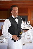 Waiter serving wine in a restaurant