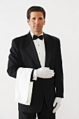 Elegant waiter in dinner jacket