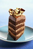 A Slice of Four Layer Chocolate Cake Topped with Chocolate Ribbon
