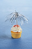A Yellow Cupcake with Festive Tinsel Toothpick Decoration