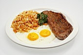 Fried Eggs with Steak and Shredded Homefried Potatoes