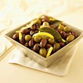 Marinated Olives with Lemon and Bay Leaves in a Bowl