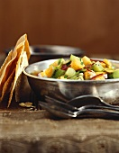 Mango, Kiwi and Red Pepper Salad in a Silver Bowl