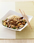 Mushroom and Beef Stir Fry with Rice and Chopsticks