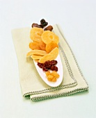 Assorted Dried Fruits on Green Linen
