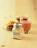 Soy Cheese in a Glass Shaker with other Soy Foods
