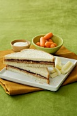 A Peanut Butter and Jelly Sandwich (PB&J) with String Cheese, Baby Carrots and Dip (Child's Lunch)
