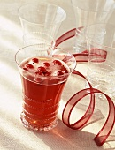 A Cranberry Cocktail with Red Ribbon