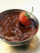 A Strawberry in a Bowl of Melted Chocolate