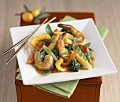 Shrimp Stir Fry on a Square White Plate with Chopsticks